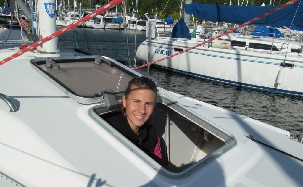 Woman peeking out of a sailboat