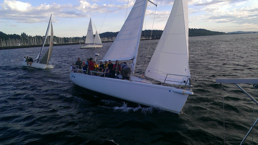 Group of people on a tilted sailboat