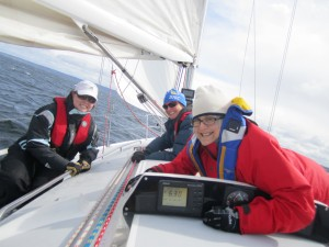 Smiling sailors on a sailboat