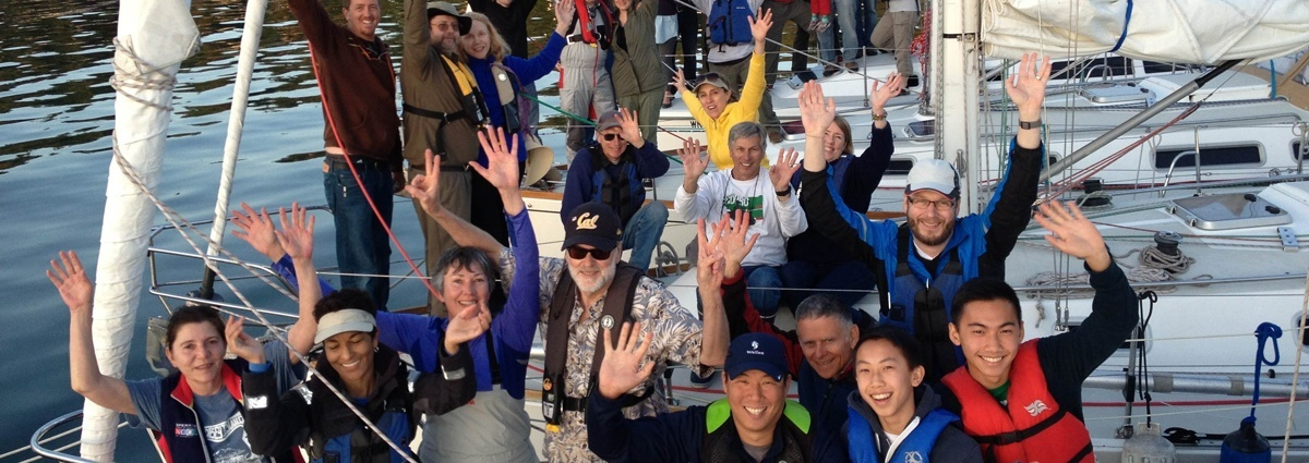 Seattle Sailing Club's Member Community: Homepage Slide of Waving Members