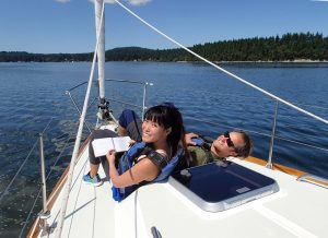 Smiling people on a sailboat - Sailing Lesson - Cruise N Learn