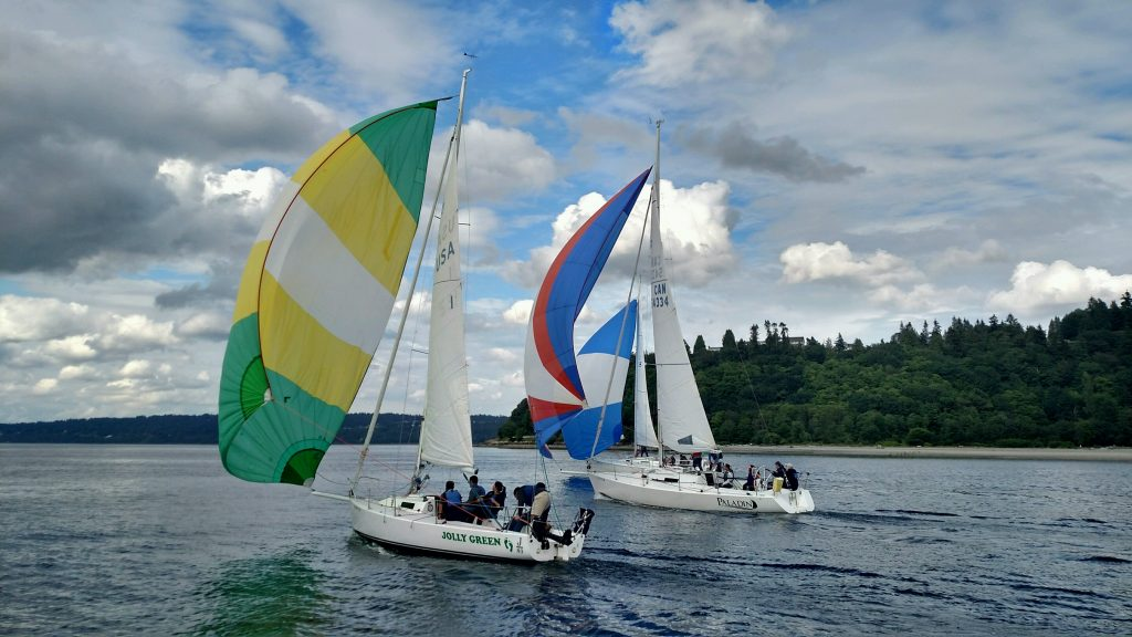 Sailboats with colorful sails: Professional Team Building Programs: Sailboats